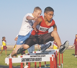 Sigala running trck at SWH. He also plays football and basketball.