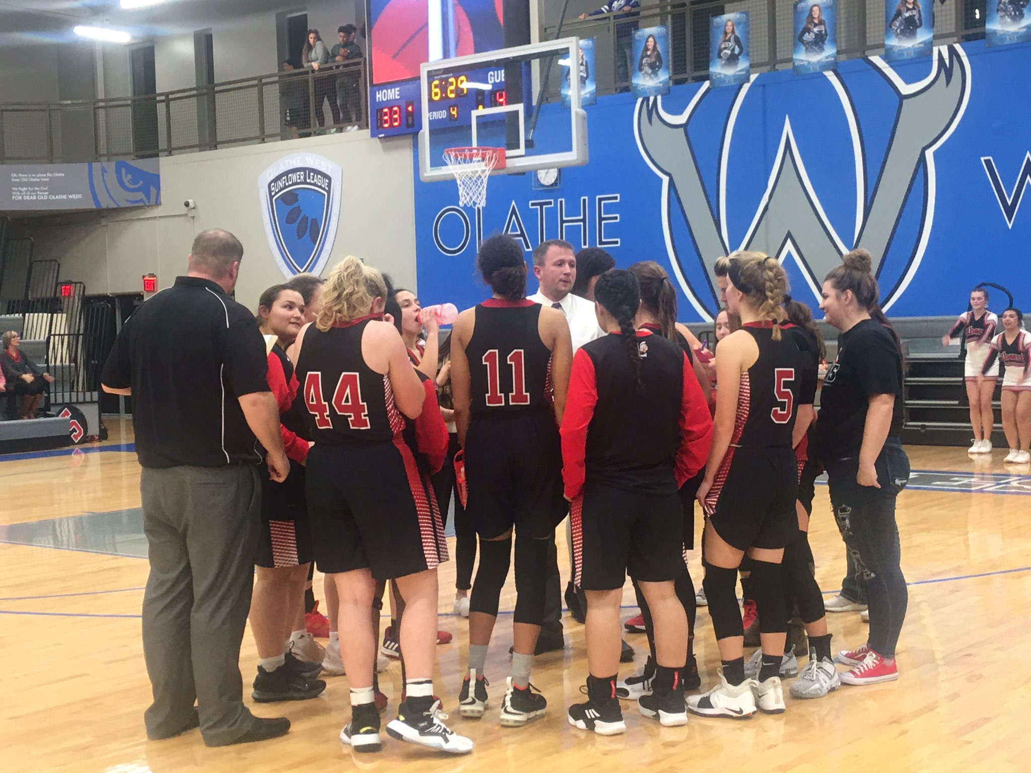 Lady Red Overwhelms Olathe West Late